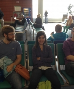 Jeff, Bea, and Olli at the airport, ready to go