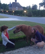 Mahdiye and Jana with a miniature horse